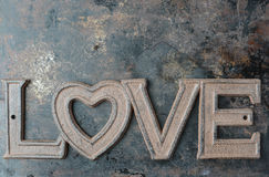The Word Love On Rustic Metal Background Stock Images