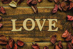 The word Love on a rustic wooden Royalty Free Stock Photo