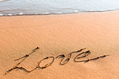 Word LOVE on sand Royalty Free Stock Photography