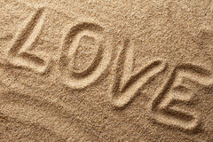 Word love on sand Stock Images