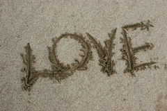 Word love on sand Stock Photo