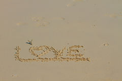 Word LOVE on sand Royalty Free Stock Images