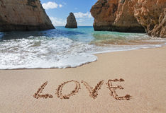 Word love in the sand on Valentine's Day. Royalty Free Stock Photography
