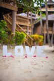 Word love on the sandy beach at beautiful resort Stock Image