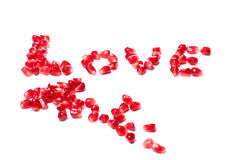 Word of love from the seeds of a pomegranate Stock Photo