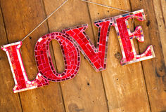 Word is Love Sign hanging on wall Stock Photos