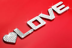Word LOVE in silver metal with diamond Stock Photos