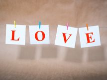 Word love on slips of paper Royalty Free Stock Images