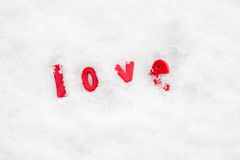 The word love in the snow Stock Photo