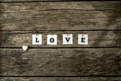 Word love spelled with individual white cards pinned to a textur Royalty Free Stock Photos