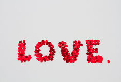 The word love spelled out of small hearts on an isolate Stock Image