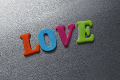 Word love spelled out using colored fridge magnets Royalty Free Stock Photos