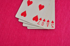 The word love spelled with playing cards Royalty Free Stock Photography