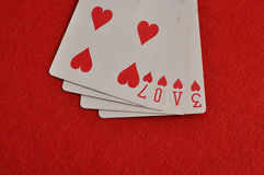 The word love spelled with playing cards. Valentines day. The word love spelled with playing cards stock photos