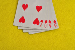 The word love spelled with playing cards Stock Images