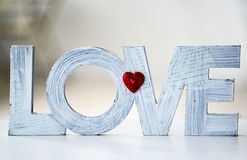 Word Love standing at home, isolated on white background stock photo