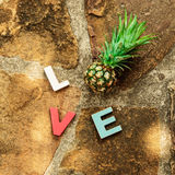 Word love on the stone floor Stock Photography