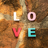 Word love on the stone floor Royalty Free Stock Images