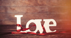 Word Love and stripes on a table. Royalty Free Stock Images