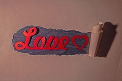 Word love in torn paper stock photo