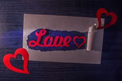 Word love in torn paper royalty free stock images