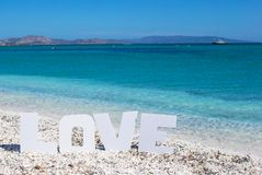 Word love on tropical beach background of the Stock Photos