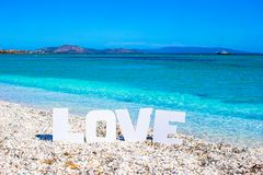Word love on tropical beach background of Royalty Free Stock Photos