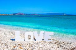 Word love on tropical beach background of Royalty Free Stock Images