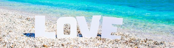 Word love on tropical beach background of Stock Photography