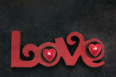 Word Love, with two small red candle, top view Stock Photo