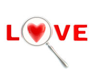 Word love under the magnifier isolated Royalty Free Stock Image