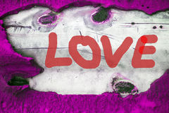 Word LOVE (uppercase) on old vintage background Royalty Free Stock Images