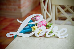 The word love and wedding bouquet Royalty Free Stock Images