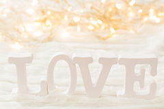 Word LOVE on white background with light bulbs. Royalty Free Stock Photos