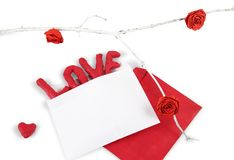 Word LOVE in the white envelope isolated on white background. royalty free stock photography