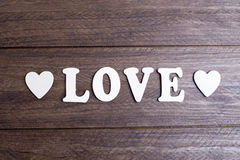 Word love with white letters between two hearts Royalty Free Stock Image