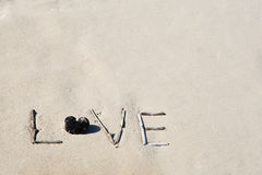 Word love on a white sand beach Stock Photography
