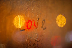 The word Love on the window in rain Stock Image