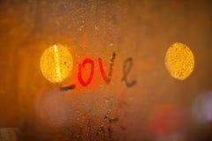 The word Love on the window in rain Stock Image