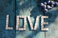 Word love ??of wooden dominoes Royalty Free Stock Photo