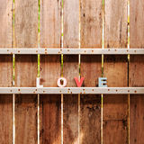 Word love on a wooden door in fence Royalty Free Stock Images