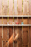 Word love on a wooden door in fence Stock Image