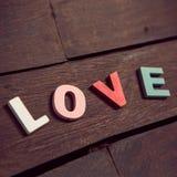 Word love on the wooden floor Stock Photo