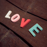Word love on the wooden floor Royalty Free Stock Photos