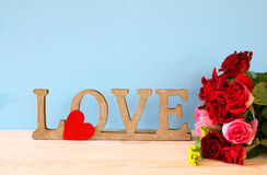 Word LOVE from wooden letters and red heart Royalty Free Stock Image