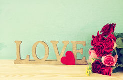 Word LOVE from wooden letters and red heart Royalty Free Stock Photography