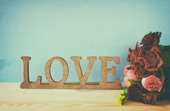 Word LOVE from wooden letters and red heart Stock Images
