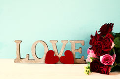 Word LOVE from wooden letters and red heart Royalty Free Stock Photo