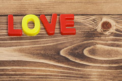 Word ''love'' on a wooden table Royalty Free Stock Image