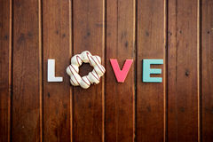 Word love on the wooden table Royalty Free Stock Images